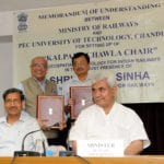 The Minister of State for Railways, Shri Manoj Sinha witnessing the signing ceremony of a Memorandum of Understanding (MoU) between Ministry of Railways and PEC University of Technology, Chandigarh, for setting up of 'Kalpana Chawla Chair' on Geospatial Technology for Indian Railways, in New Delhi on May 30, 2016. 	The Chairman, Railway Board, Shri A.K. Mital is also seen.